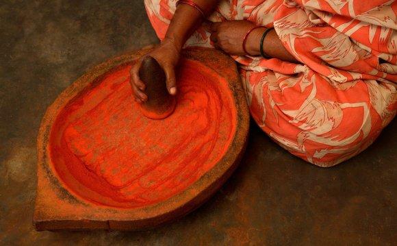 A woman prepares bhasma